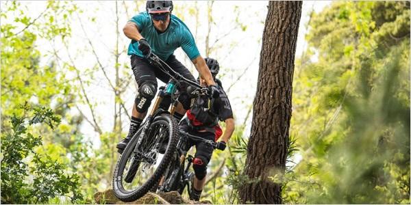 Mountain bikers riding Merida eOne-Sixty 2020s through single track trails
