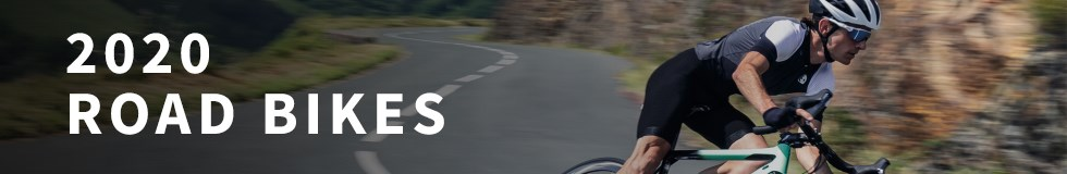 A road cycling riding along a winding road on a 2020 Cannondale road bike