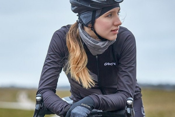 A cyclist wearing a cap and neck warmer