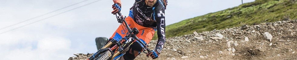 Mountain biker wearing Cube long finger gloves