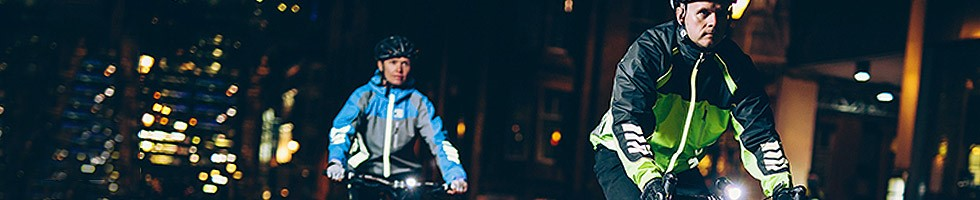 City cyclists wearing high visibility jackets