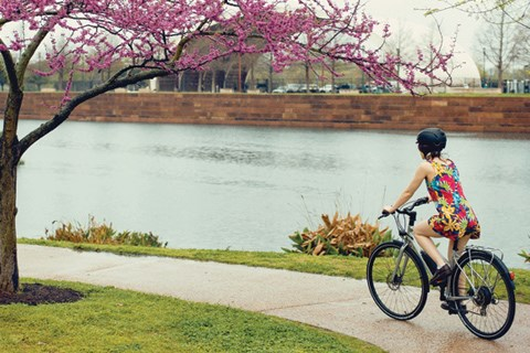 cycling by the river on a hybrid bike