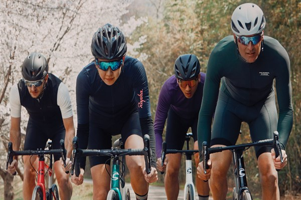 four cyclists riding road bikes